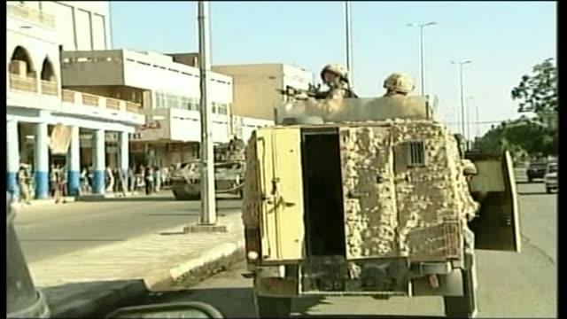 criticism of military and intelligence community 2000's british troops patrolling along street in tanks - ジュリー エッチンガム点の映像素材/bロール