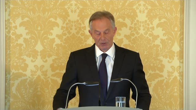 london int tony blair along to podium at press conference tony blair press statement sot the aftermath turned out to be more hostile protracted and... - tony blair stock-videos und b-roll-filmmaterial