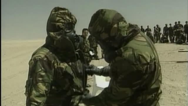 vidéos et rushes de examining britain's biggest intelligence failure in decades t16030313 / british soldiers training to put on nbc suits royal marine soldier running... - irak