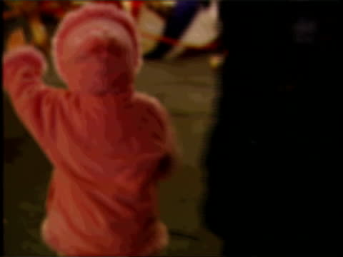 vídeos de stock, filmes e b-roll de bone disease theory i/c blurred focus shot of fairground ride eyes of anonymous woman as interviewed describing experience of having child taken into... - send
