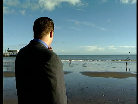 vídeos y material grabado en eventos de stock de victim fights for compensation; itn england: hampshire: isle of wight: ext child abuse victim carl august cbv august on bech looking out to sea bv... - hampshire