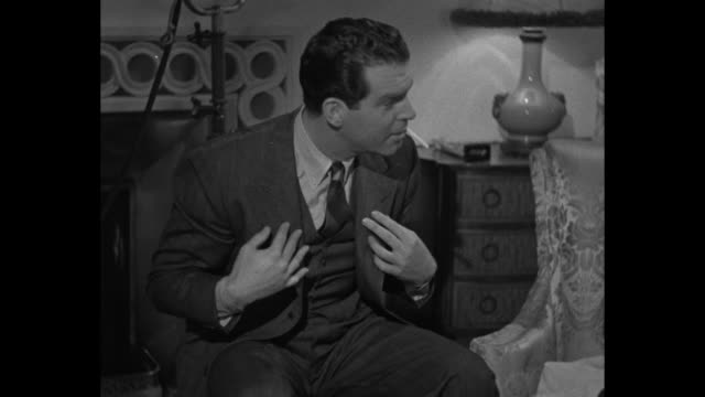 child actress carolyn lee sits in big arm chair knitting / vs on movie set fred macmurray sits next to chair that madeleine carroll sits in knitting... - ball of wool stock videos & royalty-free footage