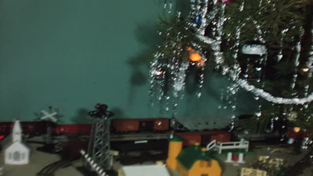 a child and a toy train underneath a 1950's christmas tree. - 1950 stock videos & royalty-free footage