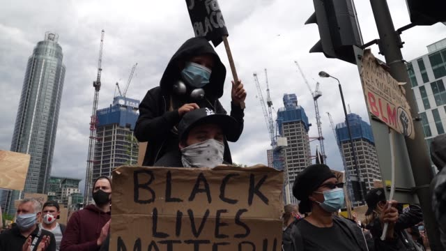 slomo a child and father join protesters at a black lives matter protest in london on june 7 2020 in london united kingdom the death of an... - parent stock videos & royalty-free footage