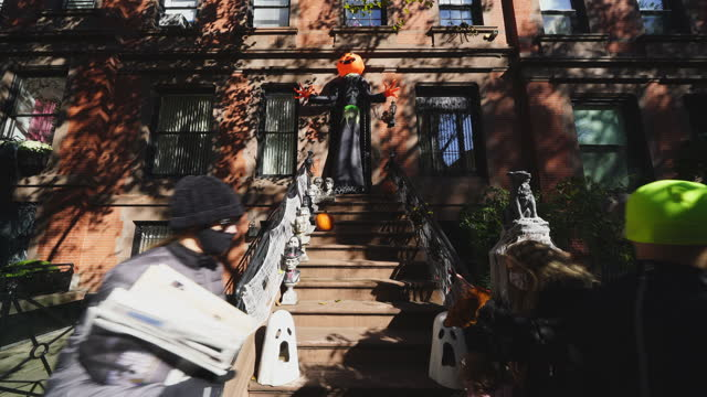 child and parent visit to the one of most popular halloween decorations in upper east manhattan area. people take photographs and enjoy to watch the... - baby girls stock videos & royalty-free footage