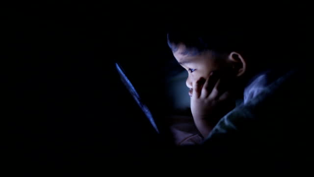 Child at home using digital tablet ,Dolly shot