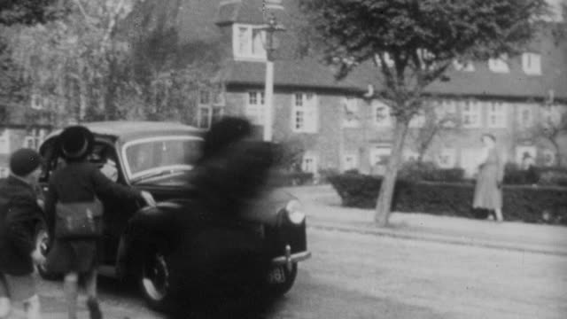 1952 ts child being picked up from school by a rolls-royce / england - rolls royce stock videos and b-roll footage