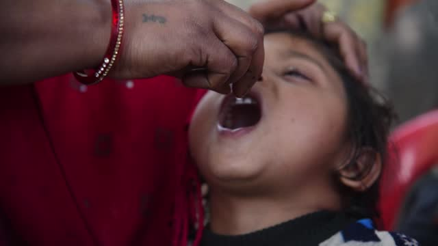 child being vaccinated for polio at a government healthcare on february 2, 2021 center in barpeta, india. the union health ministry of india aims to... - baby girls stock videos & royalty-free footage