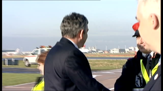 senior official implicated london heathrow airport ext car across tarmac at airport gordon brown mp out of car and shakes hands with officials on... - official car stock videos & royalty-free footage