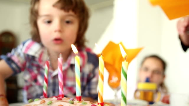 child blowing out candles on a birthday cake hd 1080p - birthday stock videos and b-roll footage