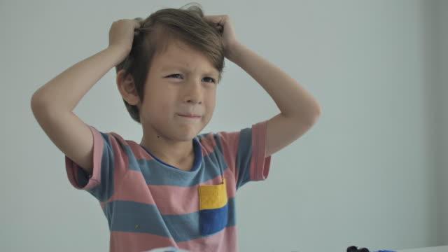 child boy having a tantrum - grimacing stock videos & royalty-free footage
