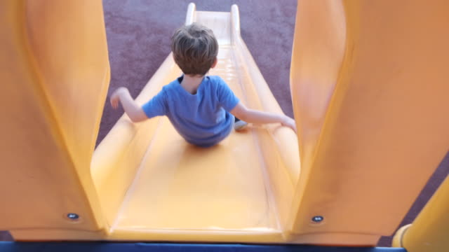 child boy playing at the playground - sliding stock videos & royalty-free footage