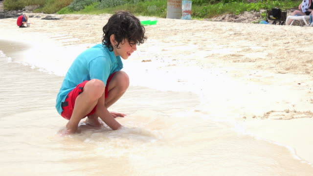 child boy playing in the white sand of santa maria key beach, cuba - uv protection stock videos and b-roll footage