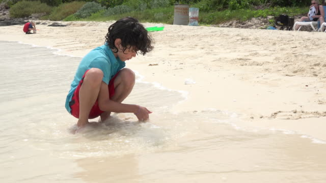 child boy playing in varadero beach, cuba - varadero stock videos and b-roll footage