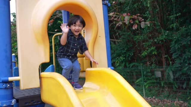 child boy sliding down slide on playground - 2 3 years stock videos & royalty-free footage