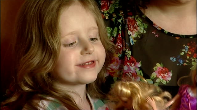 child cancer patients receive courage awards: georgina bover profile; england: kent: gravesend: int various set-ups of julie bover sitting on sofa... - patientin stock-videos und b-roll-filmmaterial