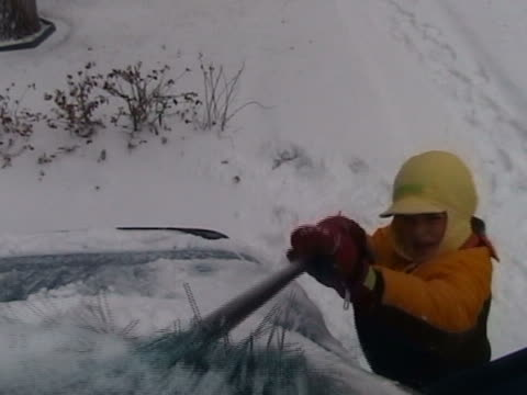 ntsc child cleaning snow off the car - mitten stock videos & royalty-free footage