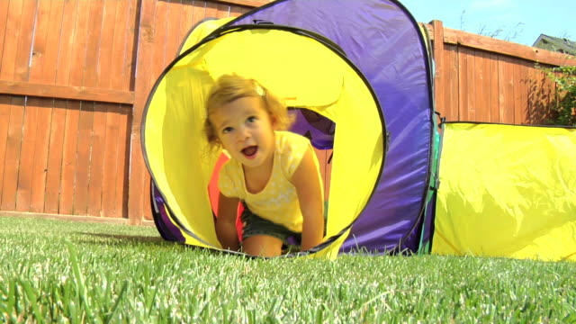 Child climb through play tunnel