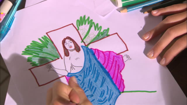 a child colors a religious drawing. - christianity stock videos & royalty-free footage
