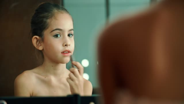 child cosmetics little girl applying make up - glamour stock videos & royalty-free footage