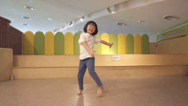 child dancing in kids cafe - one girl only stock videos & royalty-free footage