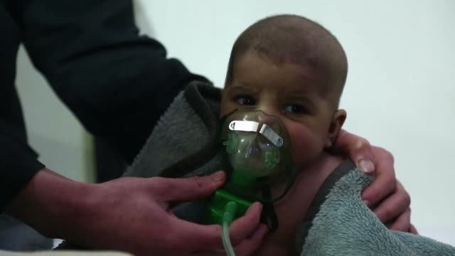 A child died and at least 13 other people suffered breathing difficulties after a suspected chemical attack on a besieged Syrian rebel enclave Sunday...