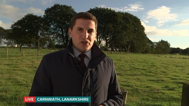 child dies after e-coli outbreak in scotland; ext reporter live to camera - escherichia coli video stock e b–roll