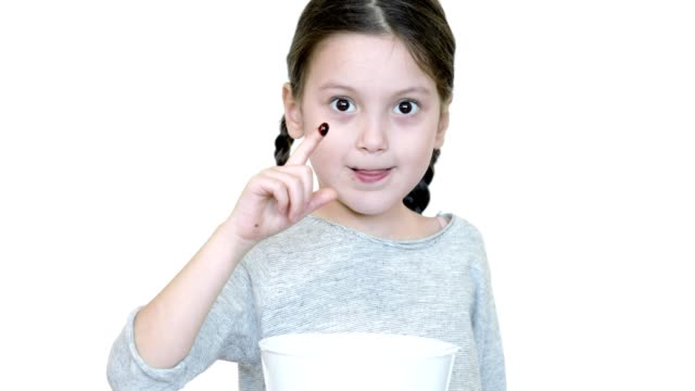 child dipping finger into chocolate sauce and licking her finger - index finger stock videos & royalty-free footage