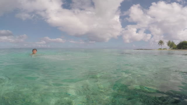 child dives into the sea - tahitian culture stock videos and b-roll footage