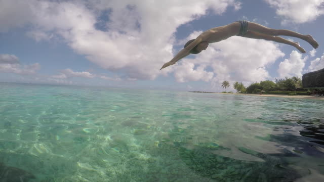 child dives into the sea - tahitian culture stock videos & royalty-free footage