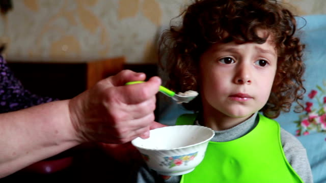child doesn't want to eat - spoon stock videos and b-roll footage