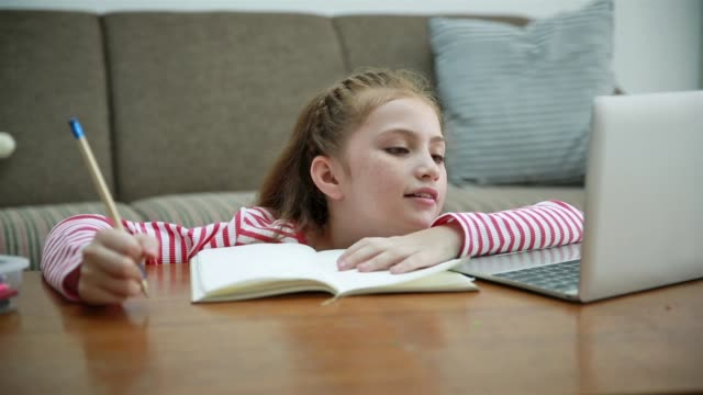 child doing homework at home - little girl webcam stock videos & royalty-free footage