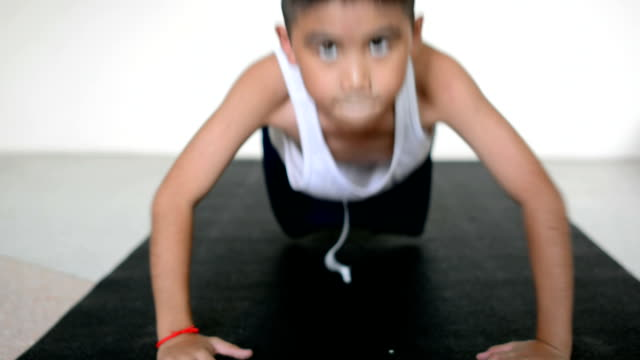 Child Doing Push-Ups At Home