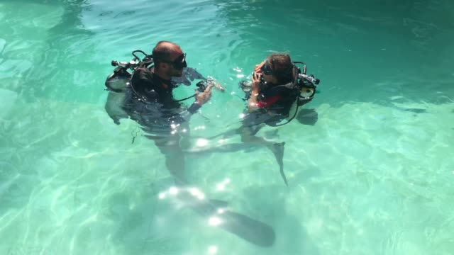 child doing scuba diving course - scuba diving stock videos & royalty-free footage