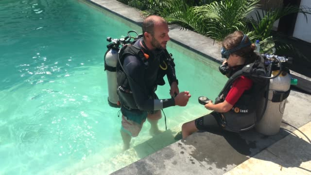 child doing scuba diving course - trainer stock videos & royalty-free footage