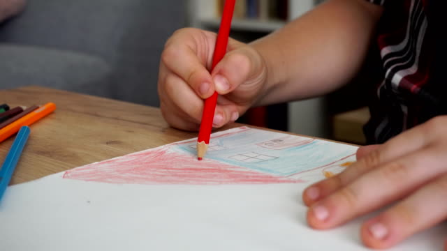 a child drawing a house with colored pencils - coloring stock videos and b-roll footage