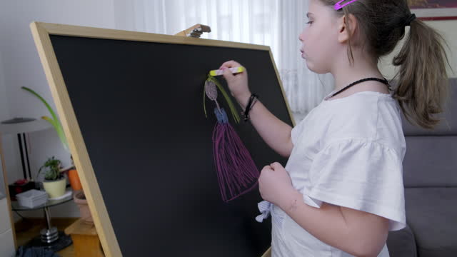 a child drawing on blackboard - one girl only stock videos & royalty-free footage