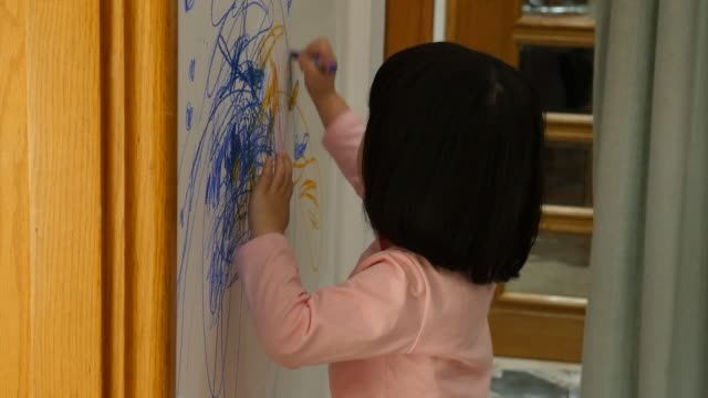 child drawing on the wall at home - scribble stock videos & royalty-free footage