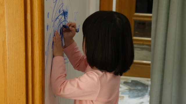 child drawing on the wall at home - chaos stock-videos und b-roll-filmmaterial