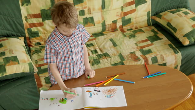 child drawing with color felt-tip pens - coloring stock videos and b-roll footage