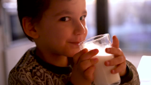 child drining milk - 4 5 years stock videos & royalty-free footage
