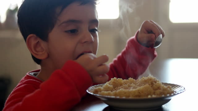 child eating at the table. - cucina domestica video stock e b–roll