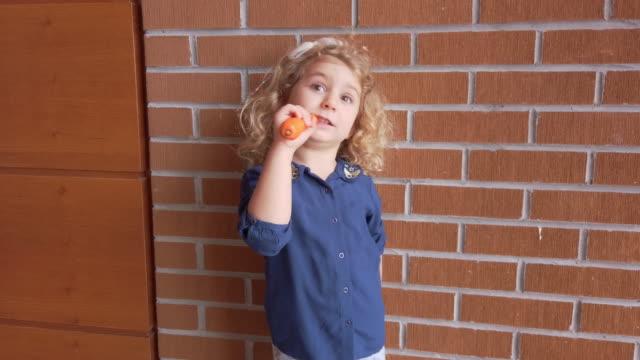 child eating carrot - beta carotene stock videos & royalty-free footage