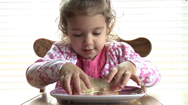 child eating sandwich - sandwich stock videos & royalty-free footage