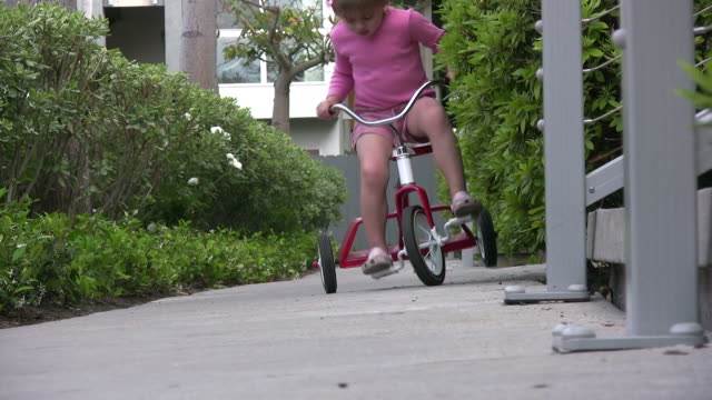 (hd1080i) child falls off bike - falling stock videos and b-roll footage