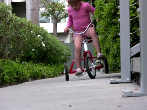 child falls off bike - tricycle stock videos & royalty-free footage