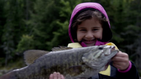 stockvideo's en b-roll-footage met child fishing for bass - fishing industry