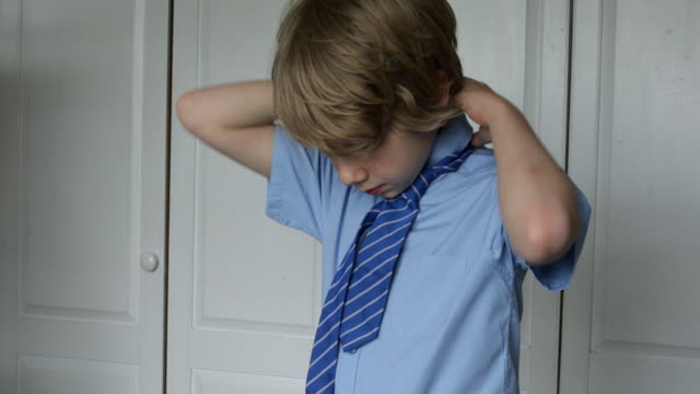 child getting ready for school - shirt and tie stock videos & royalty-free footage