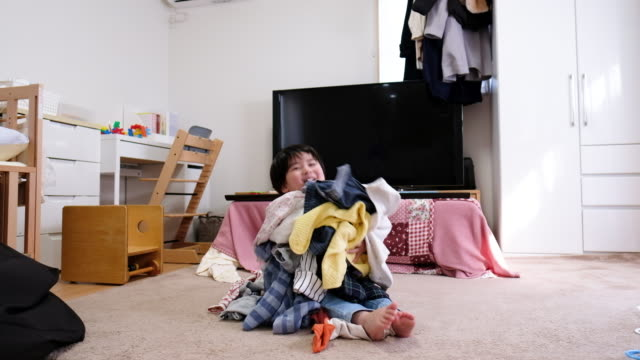 child getting room messy with laundry - mischief stock videos & royalty-free footage