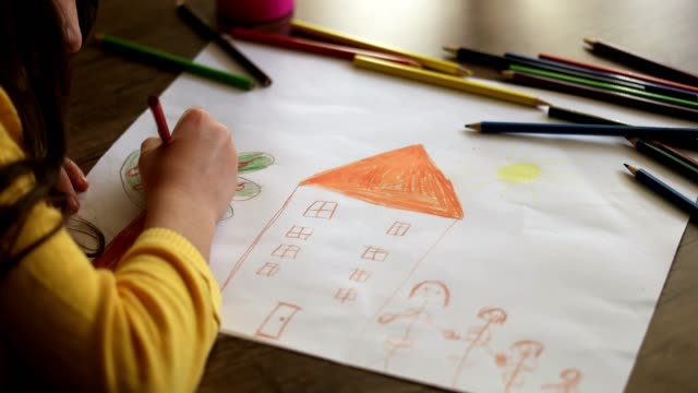 child girl draws with colored pencils - crayon stock videos and b-roll footage